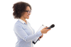 African american female reporter with microphone taking intervie Stock Photos