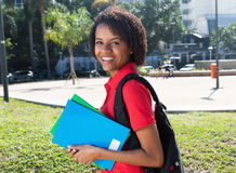African american female student laughing at camera Royalty Free Stock Image