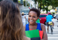 African american female student meets a caucasian girlfriend Royalty Free Stock Photo