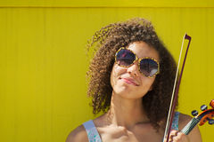 African American female with sunglasses smiling at camera Stock Images