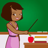 African American female teacher on blackboard Stock Image