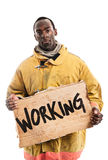 African American Firefighter Holding A Cardboard Sign With the w Royalty Free Stock Photography