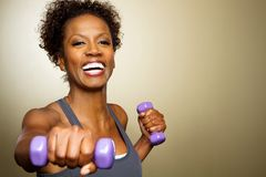 African American woman lifting weights. Royalty Free Stock Images