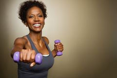 African American woman lifting weights. Stock Images