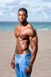 African American Fitness Model on the Beach Stock Photography