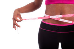 African American Fitness woman measuring her belly Stock Images