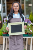 African american florist in eyeglasses holding blank sign Royalty Free Stock Photo