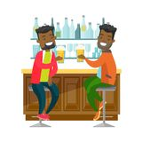 African-american friends drinking beer in a bar. Two young happy african-american men drinking beer at the bar counter and clinking glasses. Cheerful friends Royalty Free Stock Image