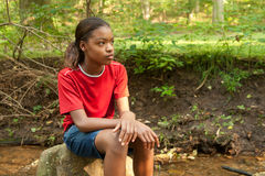 An African-American girl. An African-American girl is waiting for her friends Stock Images