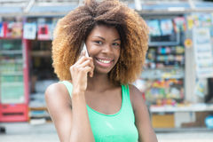 African american girl with amazing hairstyle at phone Royalty Free Stock Photos