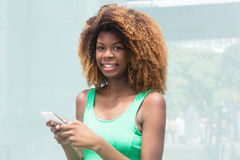 African american girl with amazing hairstyle typing message Royalty Free Stock Photography