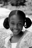 African American Girl In B&W Portrait Smile. A cute young african american girl with a smile in b&w Stock Image