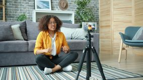 African American girl blogger recording video for internet vlog using smartphone