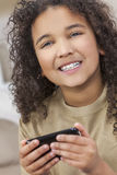 African American Girl Child Using Smat Phone Stock Images