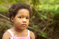 African-American girl in a creek. Stock Photos