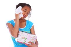 African American Girl Crying C. Isolated african american girl wiping her tear off close up with eyes closed stock photo