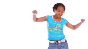 African American Girl Dancing. Isolated african american girl happily dancing with both hands up stock photo