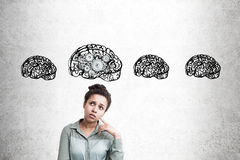 African American girl with four brain and gears sketches Royalty Free Stock Photos