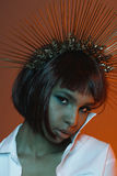 African american girl in headpiece with needles looking at camera Stock Photos