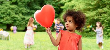 African american girl with heart shaped balloon royalty free stock photography