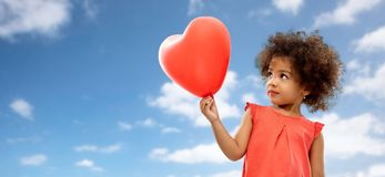 African american girl with heart shaped balloon stock photo