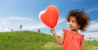 African american girl with heart shaped balloon royalty free stock image