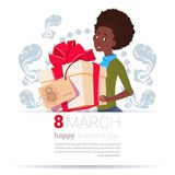 African American Girl Holding Gift Box With 8 March Tag Happy Women Day Background Creative Greeting Card Design. Flat Vector Illustration stock illustration