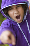African AMerican Girl in Hoodie & Baseball Cap Shouting. Young African American girl female child wearing hoody hoodie & baseball cap shouting and pointing to Stock Photography