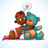 African American girl hugs Teddy Bear toy on a Stock Photography