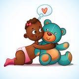 African American girl hugs Teddy Bear toy on a Stock Photography