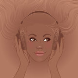 African american girl listening music in headphones Royalty Free Stock Photography