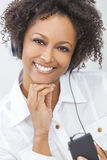 African American Girl Listening to MP3 Player Headphones Stock Images