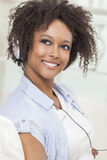 African American Girl Listening to MP3 Player Headphones Stock Photo