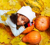 African american girl lying on pumpkin Royalty Free Stock Photos