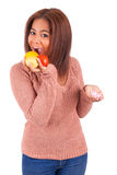 African american girl makes a choice between medicine and fruit Royalty Free Stock Photos