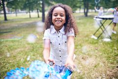 African American Girl Making Soap Bubbles royalty free stock photos