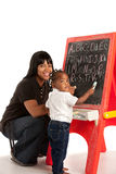 African American Girl and Mom Writing Royalty Free Stock Photography