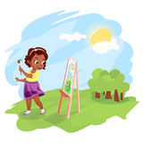 African american girl painting outdoors Stock Images