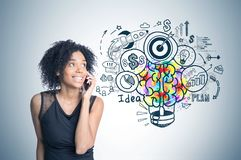 African american girl on phone, business idea royalty free stock image