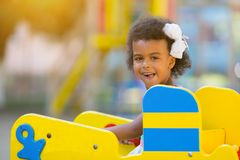 Black girl on the playground. royalty free stock images