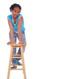 African American Girl Posing W. Isolated african american girl lean forward holding to wood bar stool Royalty Free Stock Photography