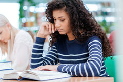 African american girl is reading Royalty Free Stock Photo