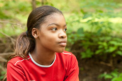 An African-American girl in a red shirt. Royalty Free Stock Photography