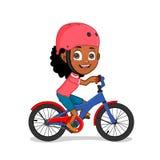 African american girl riding bike. Little smiling cute African american girl riding bicycle in helmet Stock Image