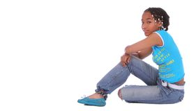African American Girl Sitting. Isolated african american girl sit on the floor stock photos