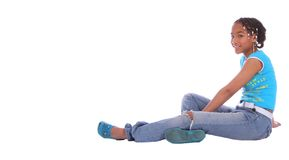 African American Girl Sitting. Isolated african american girl relaxing on the floor Stock Photos