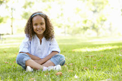 African American Girl Sitting In Park Royalty Free Stock Photo