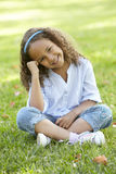 African American Girl Sitting In Park Royalty Free Stock Photos