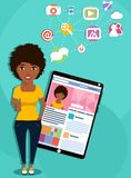 African-American girl with a tablet computer. The concept of social networking. African-American girl with a tablet computer showing a social network. Personal Royalty Free Stock Image