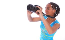 African American Girl Taking P. Isolated close up african american girl taking picture with digital camera royalty free stock photos